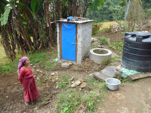 Nepalese woman with bio-gas digester